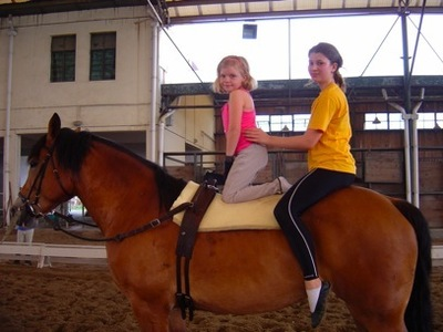 me and my friend at a race with one of my horses!!